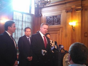 MGM CEO Jim Murren speaks to reporters as MGM Springfield head Mike Mathis and Mayor Sarno look on. (WMassP&I)