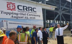 Baker at CRRC with ironworkers in August. (via wamc.org)